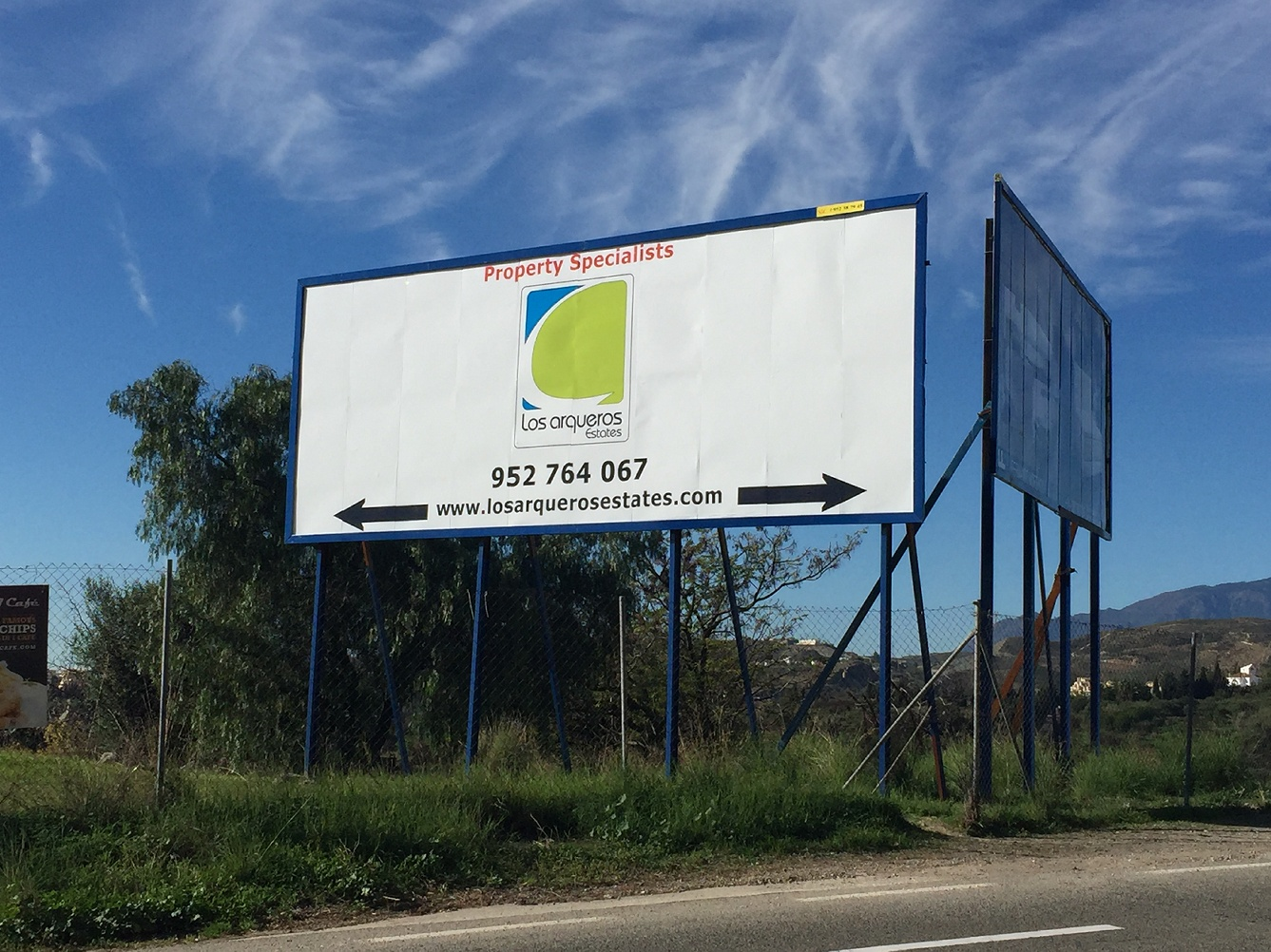Roadside banner_Ronda road_Advertising on a busy junction near Los Arqueros Golf